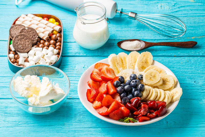 Ingredients for fruit milkshakes. On blue table royalty free stock photography