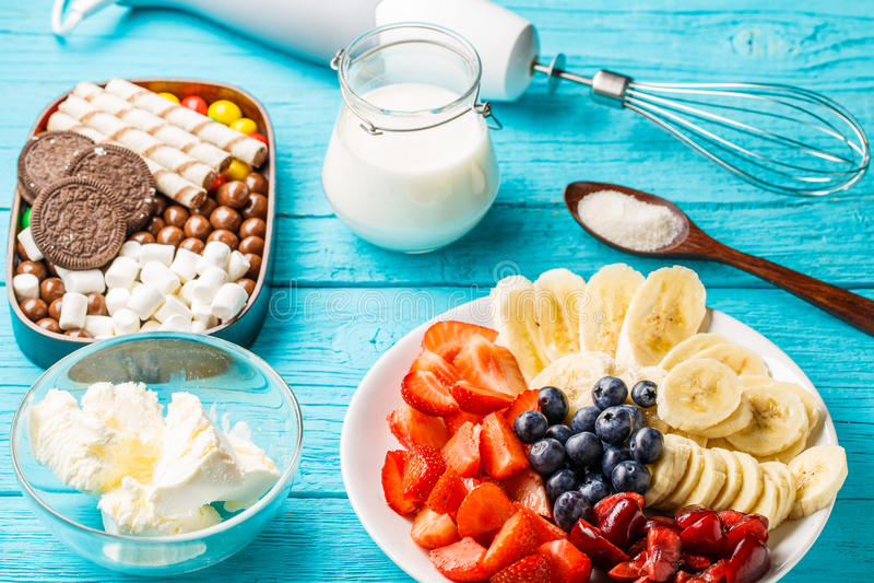 Ingredients for fruit milkshakes. On blue table stock images