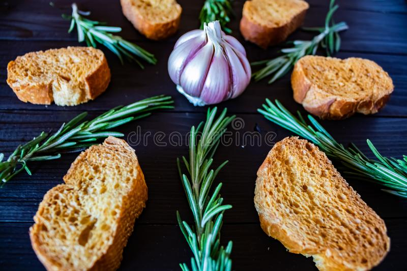 Ingredients for garlic soup in composition. On wooden background culture white rice cooking natural dinner above flavor dish herbal top fresh food mortar royalty free stock images