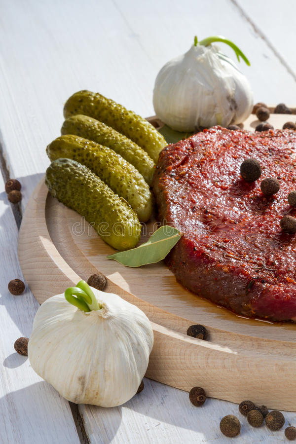 Ingredients for grilled steak with vegetables stock image