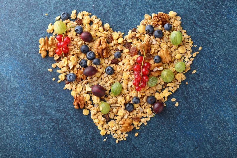 Ingredients for healthy cereal breakfast in shape of heart. Food above stock photos