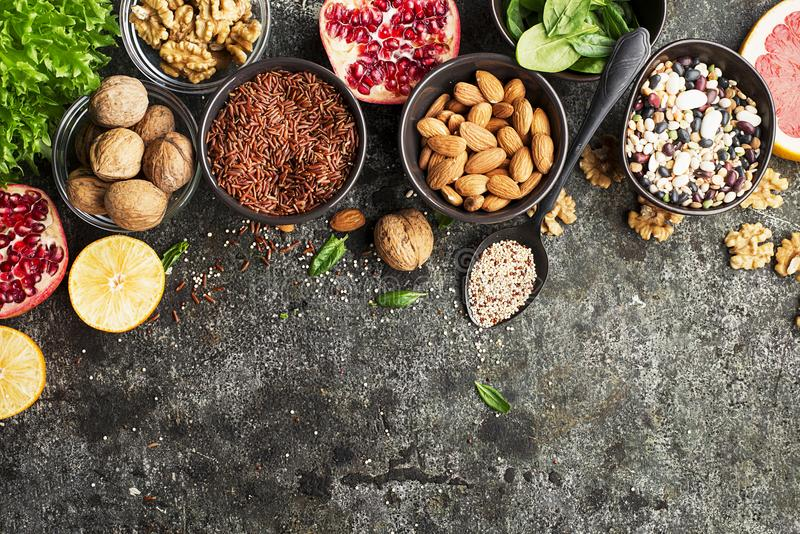 Ingredients of a healthy diet for drawing up a meal plan: wild brown rice, quinoa, spinach, legumes, oranges, grapefruit royalty free stock photos