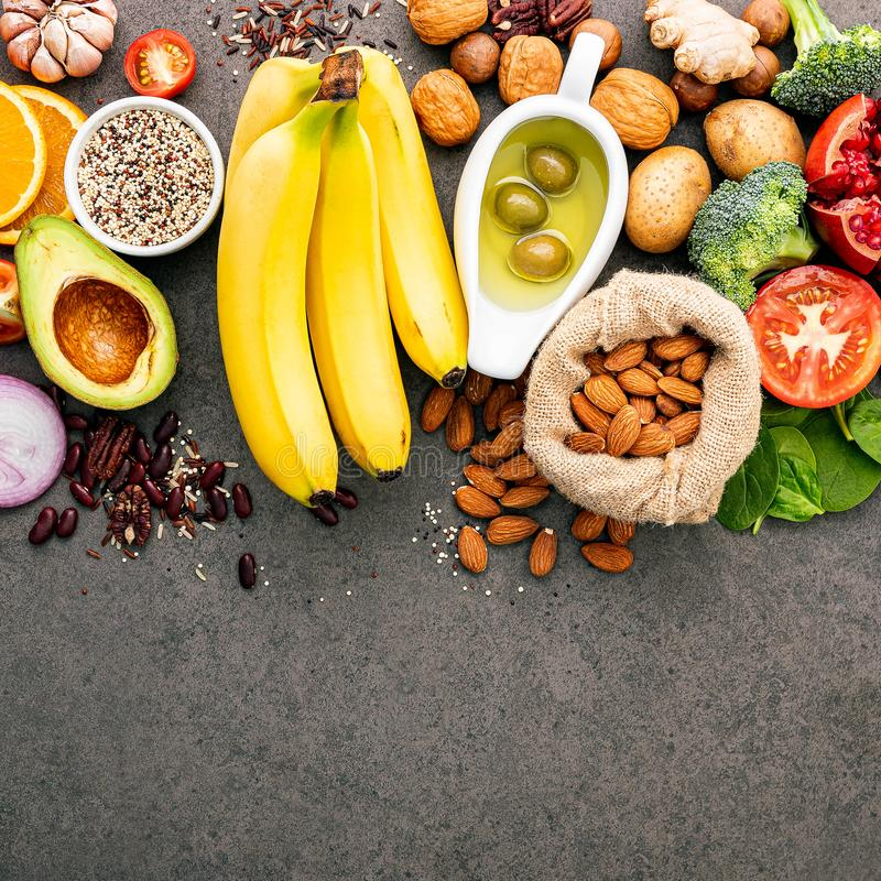 Ingredients for the healthy foods selection  .The concept of healthy food set up on dark concrete background copy space stock image