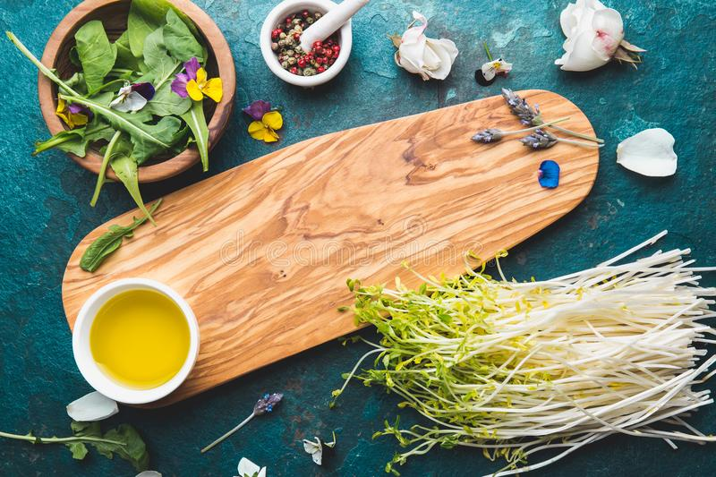 Ingredients for healthy salad - lettuce, sprouts, edibles flowers and arugula. Flat lay, copy space food. Detox. Organic. Nutrition. Salad leaves with herbs and royalty free stock photo