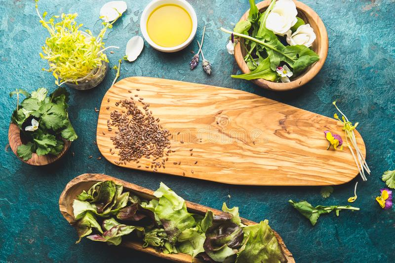 Ingredients for healthy salad - lettuce, sprouts, edibles flowers and arugula. Flat lay, copy space food. Detox. Organic. Nutrition. Salad leaves with herbs and stock image