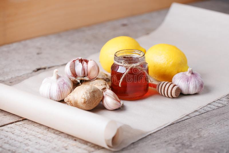 Ingredients for healthy tea with herbs, honey, ginger, garlic and lemon, seasonal traditional flu remedy drink, alternative stock image
