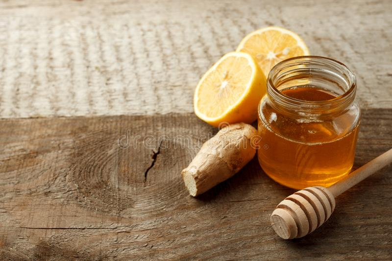 Ingredients for herbal medicine lemon, ginger, honey. Natural products to support the immune system in winter, vintage wooden back royalty free stock images