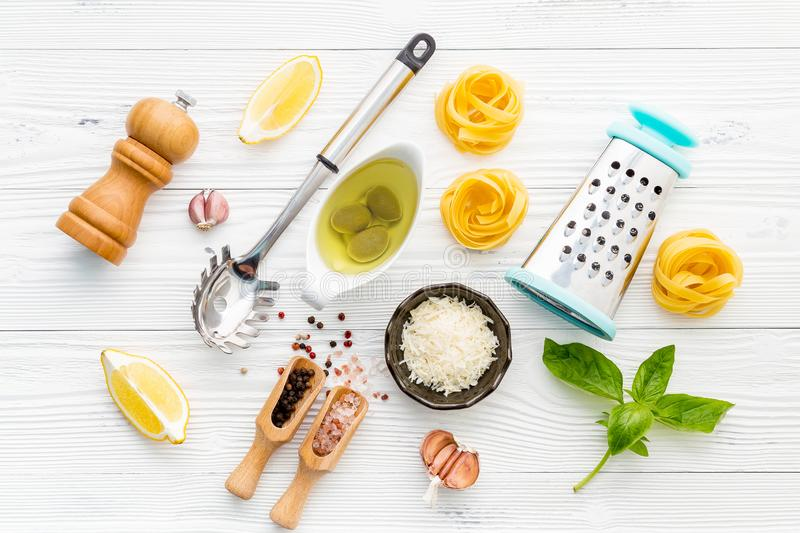 The ingredients for homemade pesto pasta on white wooden background. royalty free stock photo