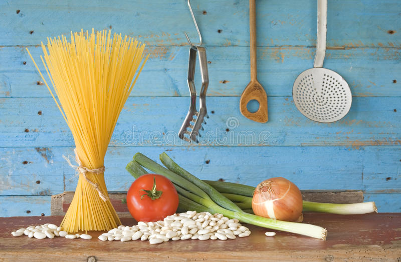 Ingredients for italian dish, spaghetti with white beans royalty free stock photo