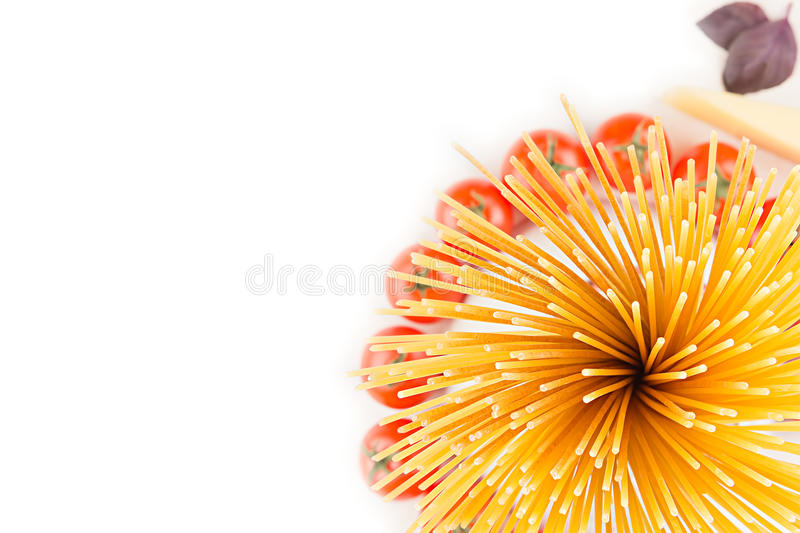 Ingredients Italian pasta top view - sheaf spaghetti, cherry tomatoes, basil, cheese on white wood board with empty copy space a. S decorative border background stock image