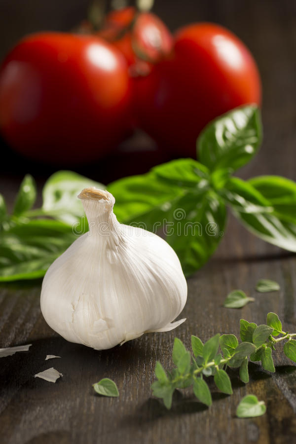 Ingredients for Italian Recipes: Garlic, Basil, Oregano and Tomatoes royalty free stock photo