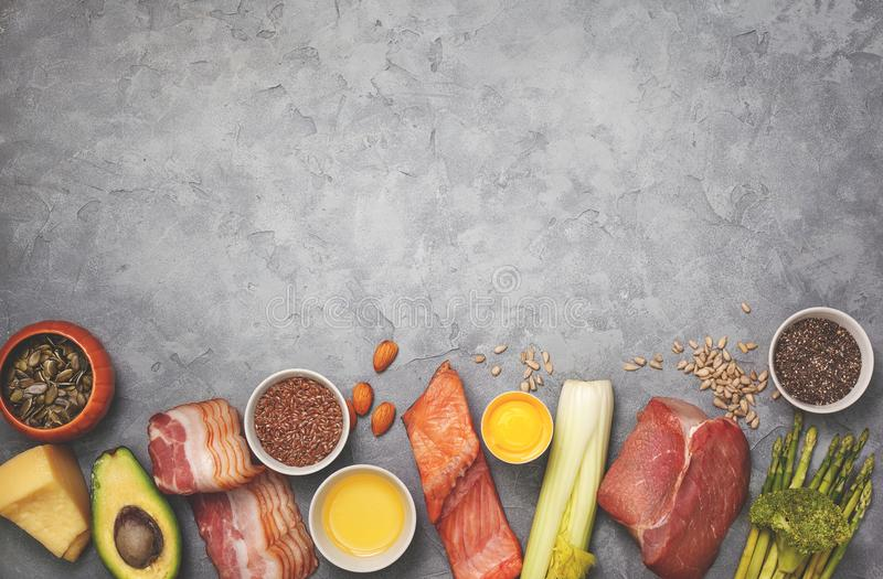Ingredients for ketogenic diet. Meat, bacon, fish, broccoli, asparagus, avocado, mushrooms, cheese, sunflower seeds, chia seeds, pumpkin seeds, flax seeds on a royalty free stock images