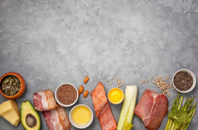 Ingredients for ketogenic diet. Meat, bacon, fish, broccoli, asparagus, avocado, mushrooms, cheese, sunflower seeds, chia seeds, pumpkin seeds, flax seeds on a stock photos