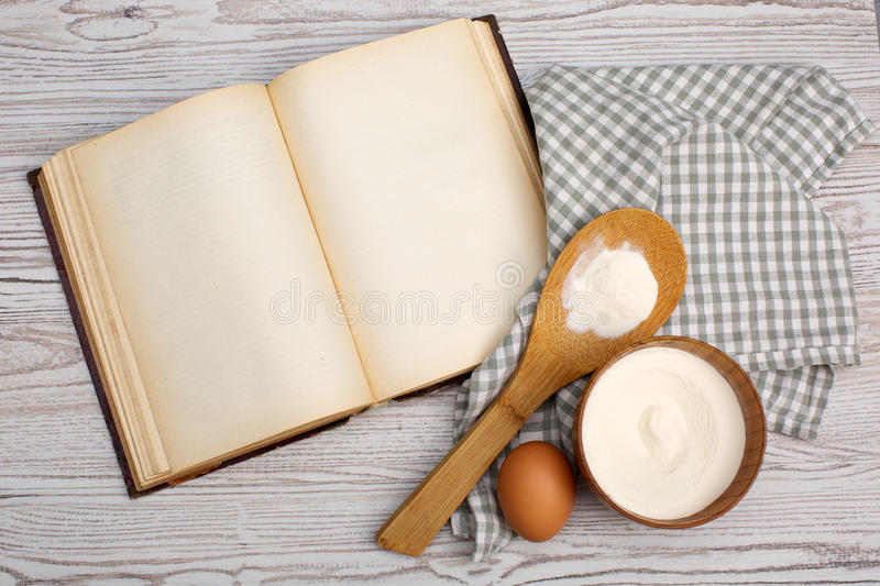 Ingredients and kitchen tools with the old blan. Cooking concept. Ingredients and kitchen tools with the old blank recipe book royalty free stock images