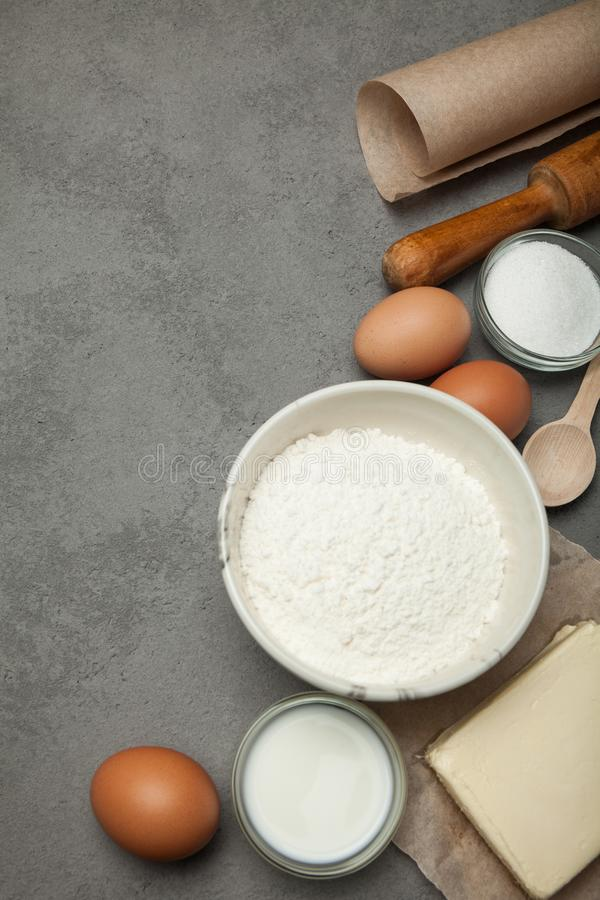 Ingredients for making dough for pizza or pasta, vertically.  royalty free stock photos