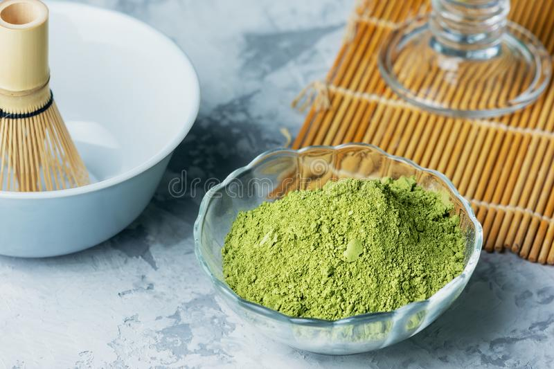 Ingredients for making matcha green tea. Powdered green tea, whisk and bowl. Close-up photo stock photos