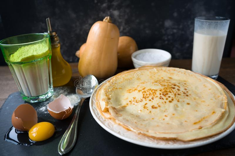 Ingredients for making pancakes - egg, butter, milk, sugar and raw dough, Rustic or rural style stock image