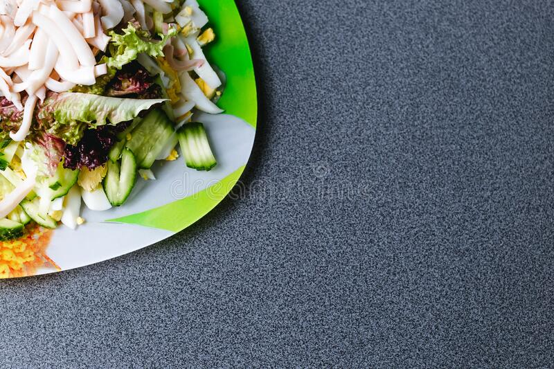 Ingredients for making salad on a green plate stock photography