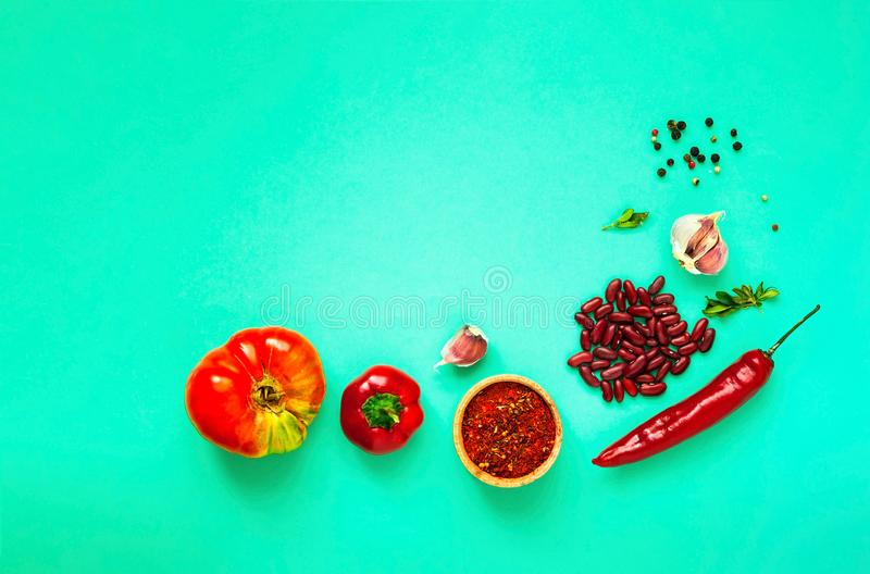 Ingredients for making spicy soup with beans on a green background. Mexican food concept royalty free stock photos