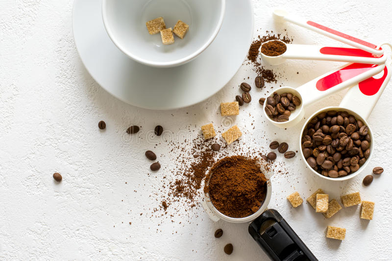 Ingredients for natural coffee: ground coffee in the horn of the stock images