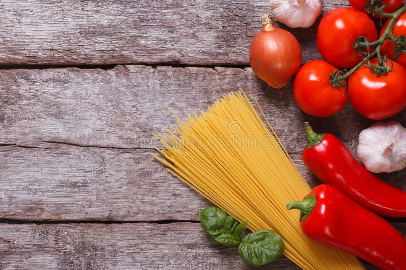 Ingredients for pasta: spaghetti, vegetables on an old table royalty free stock image