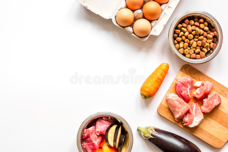 Ingredients for pet food holistic top view on white background.  stock images