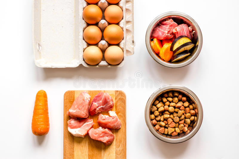 Ingredients for pet food holistic top view on white background.  royalty free stock photo