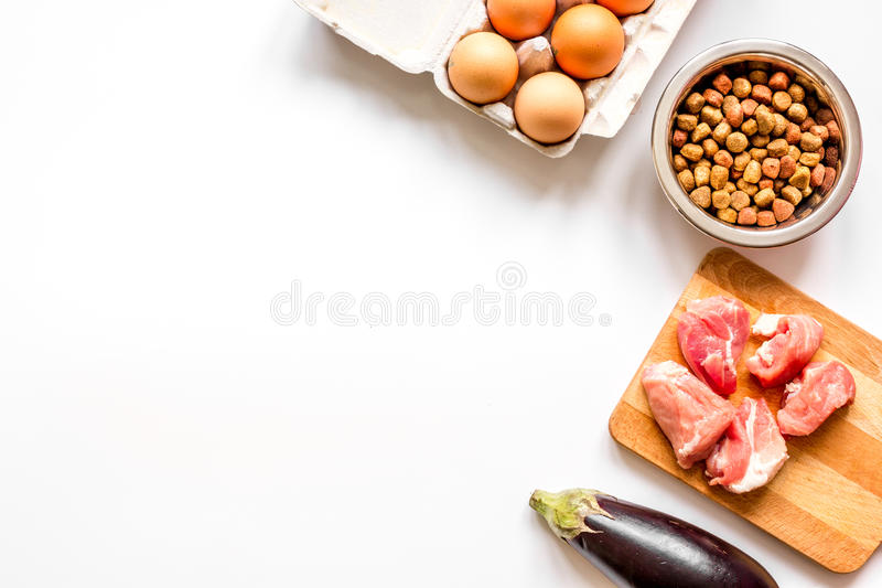 Ingredients for pet food holistic top view on white background.  royalty free stock photos