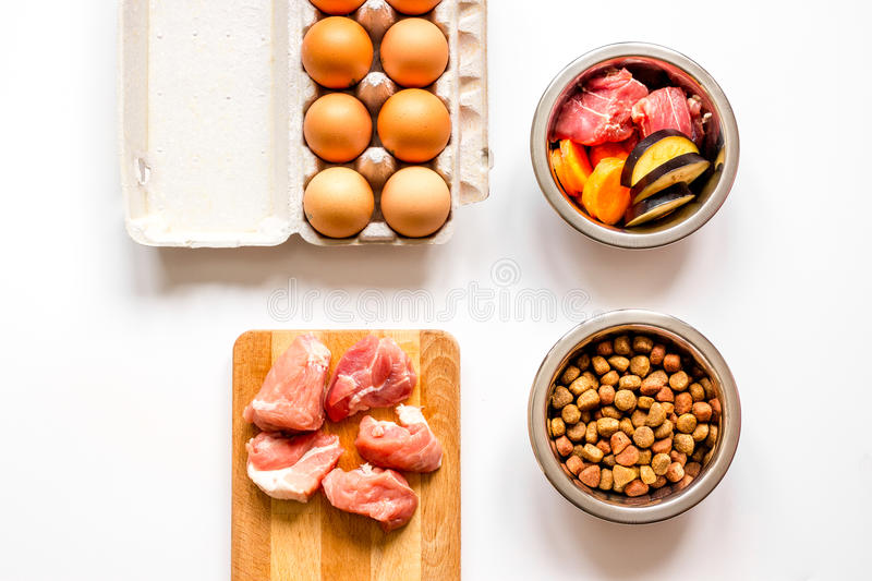 Ingredients for pet food holistic top view on white background.  royalty free stock image