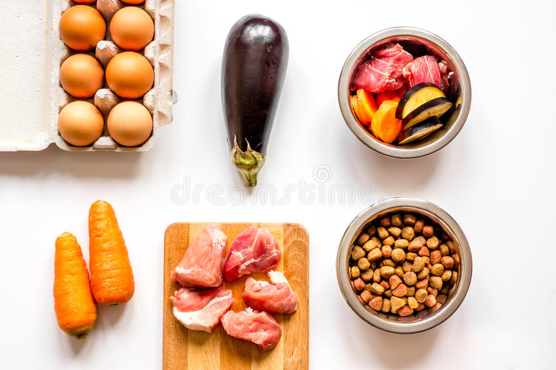 Ingredients for pet food holistic top view on white background.  stock image