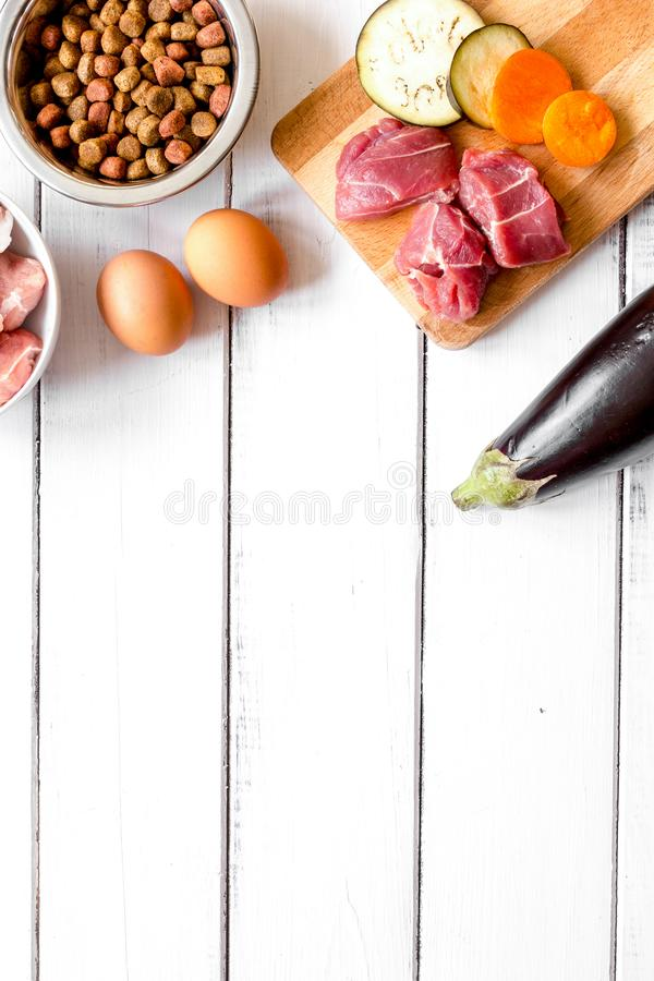 Ingredients for pet food holistic top view on wooden background.  royalty free stock image