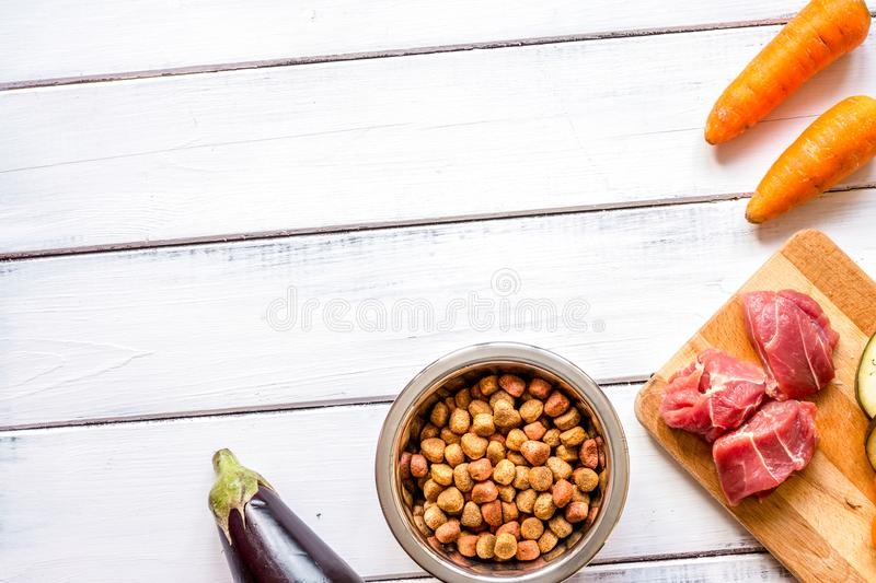 Ingredients for pet food holistic top view on wooden background.  royalty free stock images