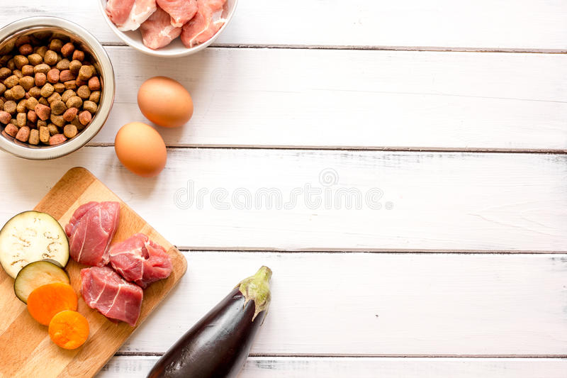 Ingredients for pet food holistic top view on wooden background.  royalty free stock photos