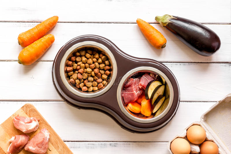 Ingredients for pet food holistic top view on wooden background.  stock photos