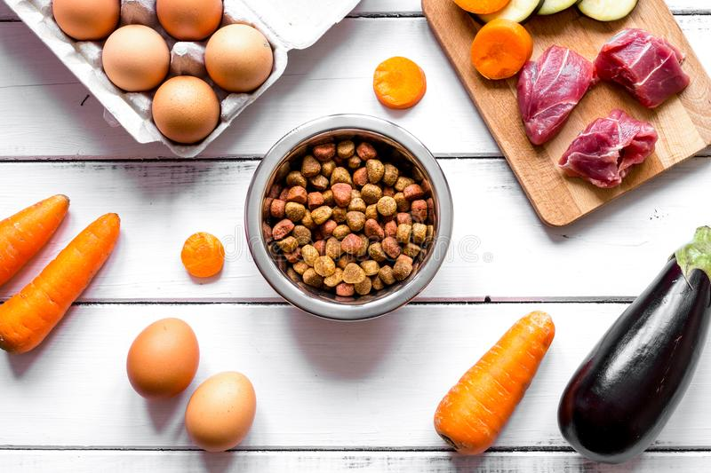 Ingredients for pet food holistic top view on wooden background.  stock images