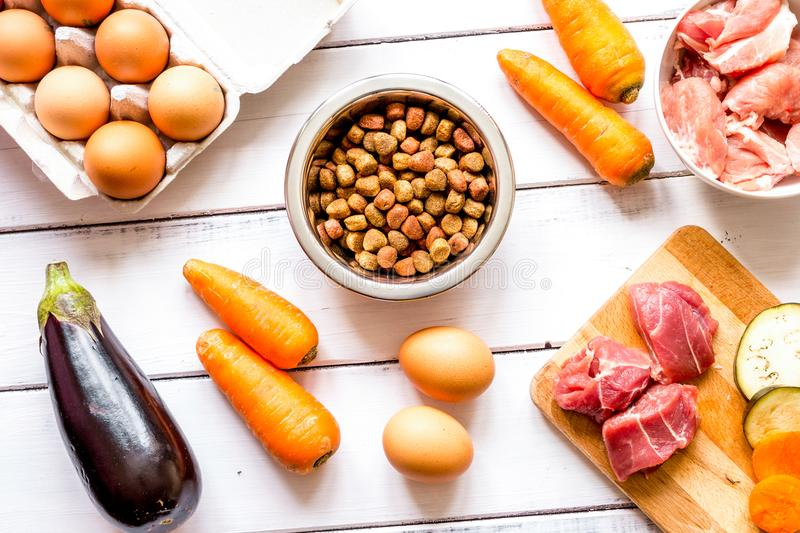 Ingredients for pet food holistic top view on wooden background.  stock image