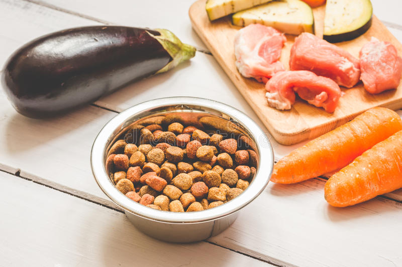 Ingredients for pet food natural on wooden background. Close up stock photos