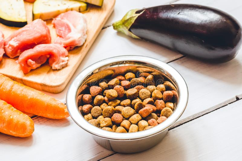 Ingredients for pet food natural on wooden background. Close up stock photo