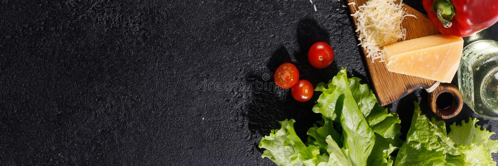 Ingredients for pizza. Tomatoes, olive oil, greens and parmesan on a wooden background. Copy space stock photos