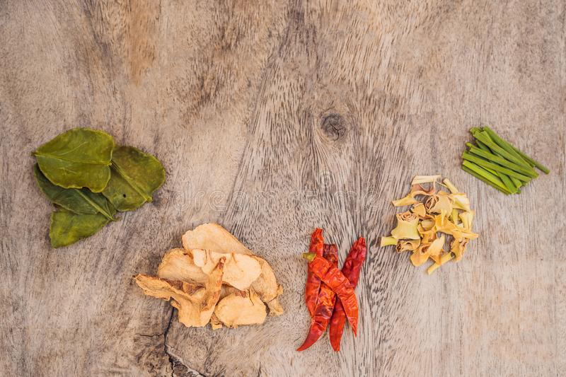 Ingredients for popular Thai soup Tom-yum kung. Lime, galangal, red chili, cherry tomato, lemongrass and kaffir lime royalty free stock photography