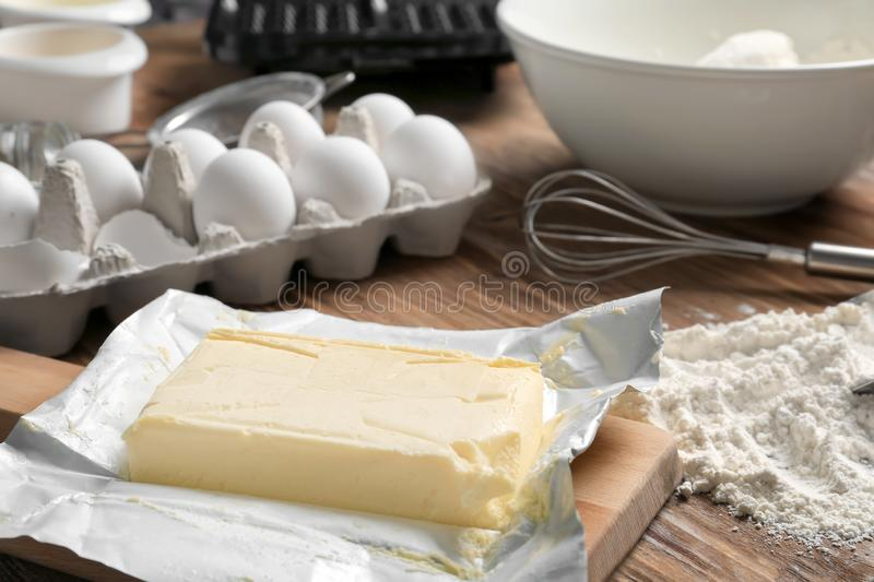 Ingredients for preparing of delicious waffles on wooden table royalty free stock images