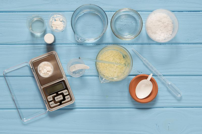 Ingredients for production of natural beauty cosmetics, close-up. Ingredients for production and packaging of natural beauty cosmetics, oil, scale, pipette on stock image