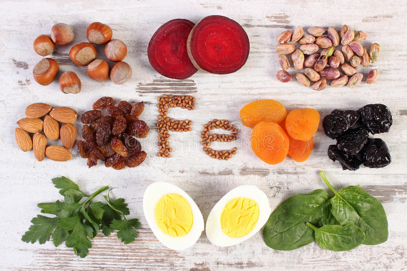 Ingredients and products containing iron and dietary fiber, healthy nutrition. Inscription Fe, ingredients and product containing iron and dietary fiber, natural stock photo