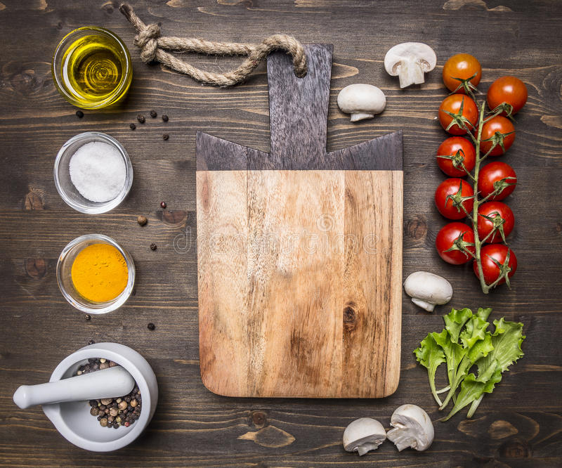 Ingredients salad, oil, cherry tomatoes, lettuce, spices wooden rustic background top view close up place text,fram stock image