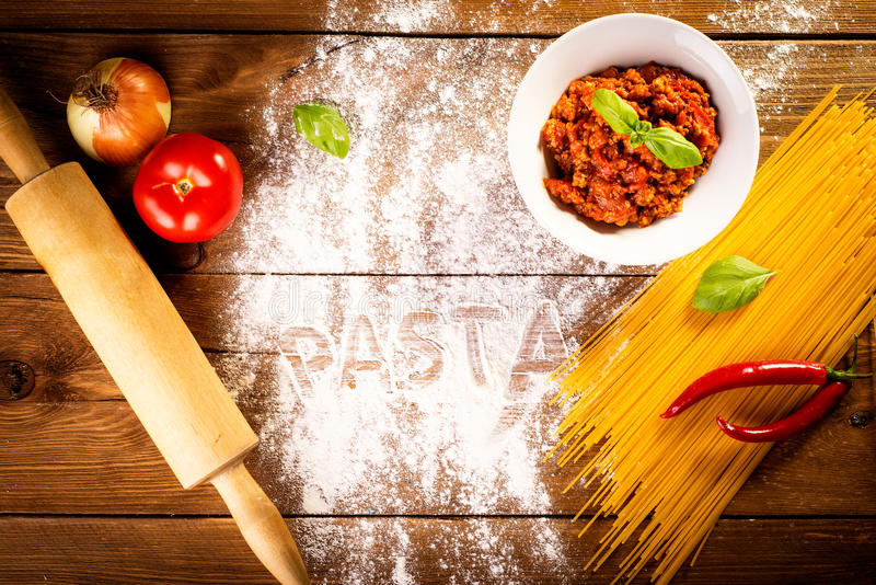 Ingredients for spaghetti on a wooden table royalty free stock photo