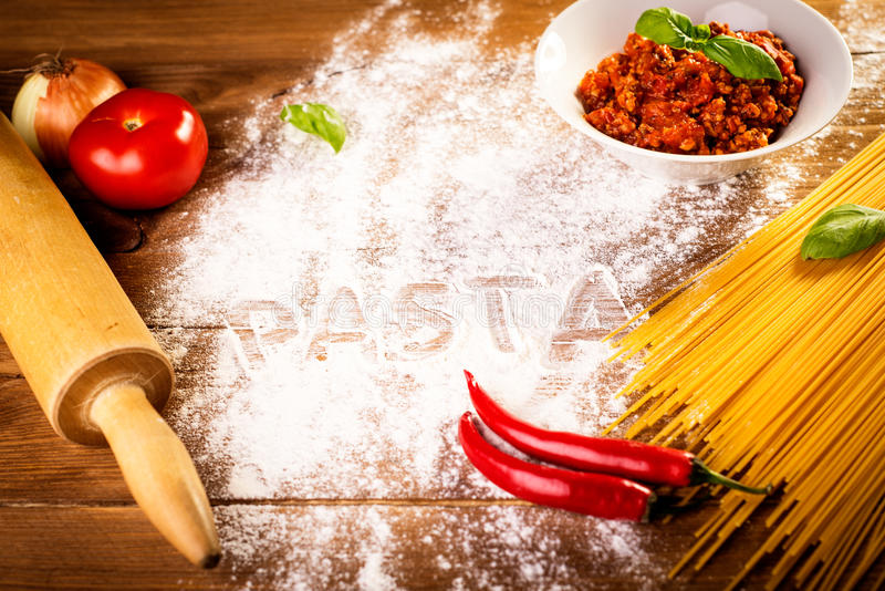Ingredients for spaghetti on a wooden table stock images