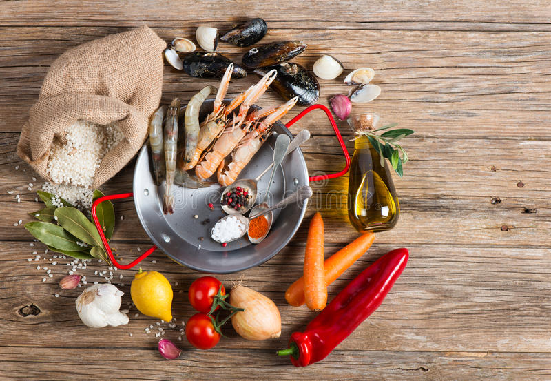 Ingredients of spanish seafood paella, top view stock images