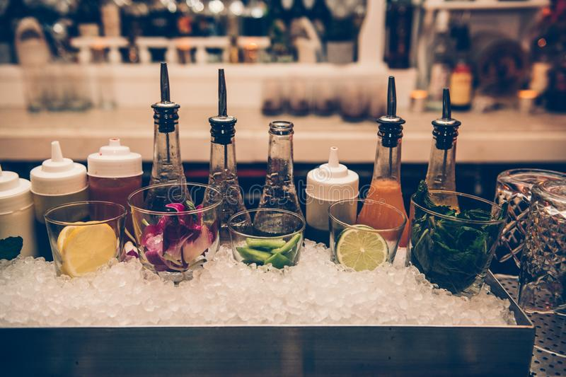 Ingredients and syrups for cocktails at bar counter in the the nightclub. stock photo