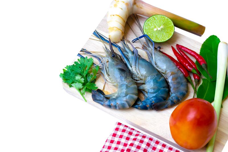 Ingredients for thai food making Tom Yum Kung with shrimp. Galangal, lemon, Lemon Grass,chilli, tomato,  Kaffir lime leaf on a white background royalty free stock photography