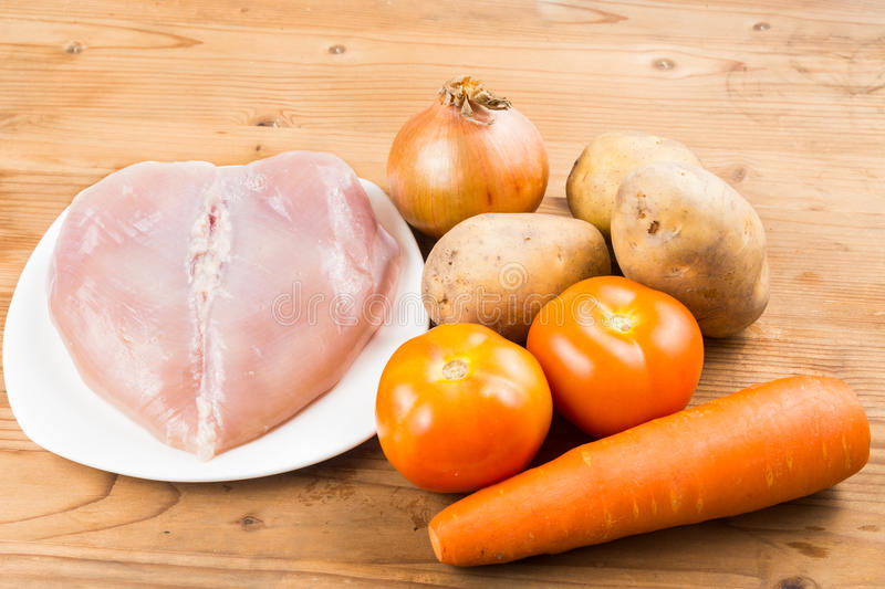 Ingredients to double boil Chinese potatoes, carrots, tomatoes soup.  stock photography